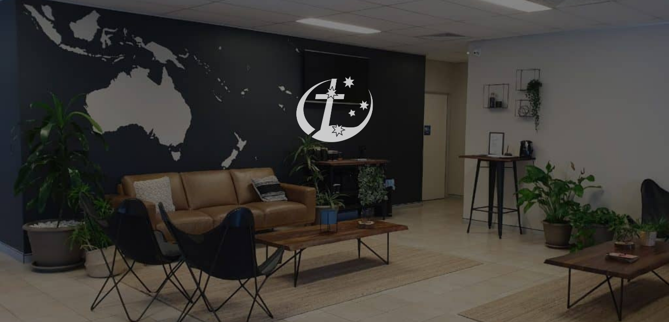 Southern-Cross-Educational-Enterprise-logo-in-the-middle-with-a-photo-background-of-the-foyer.